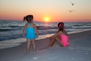 Two girls watching a sunset.