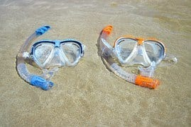Snorkel masks in the surf.